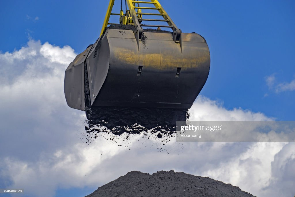A crane unloads the first shipment of anthracite coal from U.S. supplier XCoal Energy & Resources LLC, for state energy firm Centrenergo PJSC, onto the dockside at Yuzhny Port, near Odessa, Ukraine, on Wednesday, Sept. 13, 2017. A Pennsylvania company will send 700,000 tons of coal to Ukraine in a deal the administration of PresidentDonald Trumpheralded as an important tool to undercut the power Russia has over its European neighbors. Photographer: Vincent Mundy/Bloomberg via Getty Images