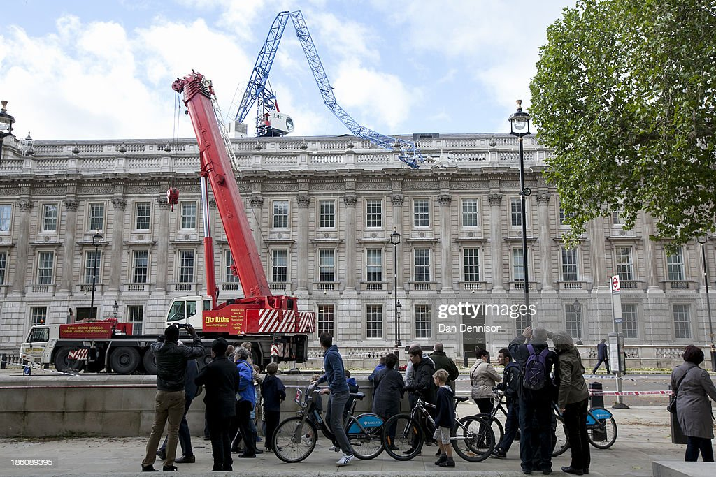 A crane which collapsed during the storm lies on the Cabinet Office roof on October 28, 2013 in London, England. Approximately 220,000 homes are without power and two deaths have been recorded after much of southern England has been affected by a severe storm. Transport links on road, rail, air and sea have been severely disrupted by hurricane-force winds that have almost reached 100 mph in places.