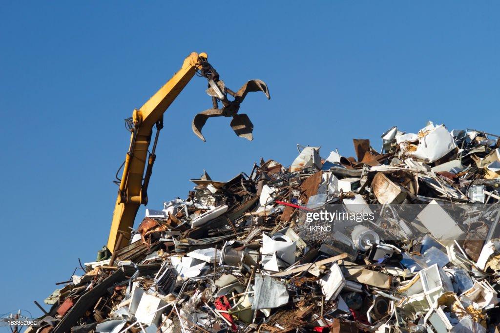 'Crane With Open Claw, Metal Recycling Junkyard, Blue Sky'