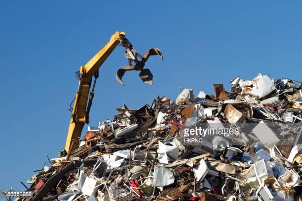 Crane With Open Claw, Metal Recycling Junkyard, Blue Sky