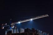 cranes and illumination at night, construction site.