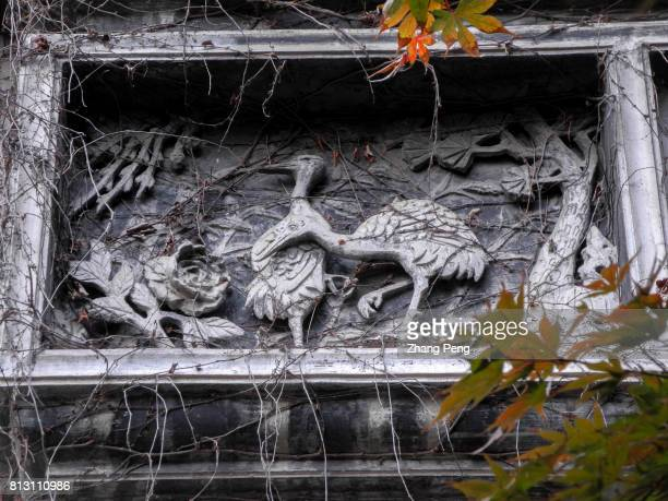 Cranes and pine trees carved on stone and decorated on the wall means happiness and longevity in Chinese tradition The Retreat Reflection Garden...
