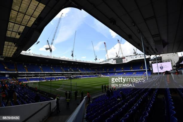 Cranes are seen above White Hart Lane in London on May 14 2017 ahead of the English Premier League football match between Tottenham Hotspur and...