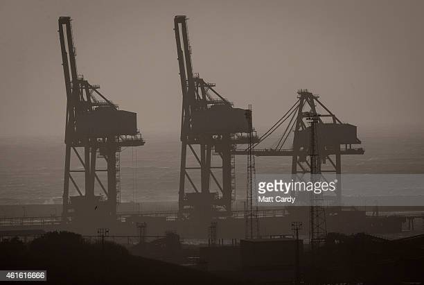 Cranes are seen at the dockside on January 15 2015 in Port Talbot Wales Along with health and education manufacturing and the economy are to be key...