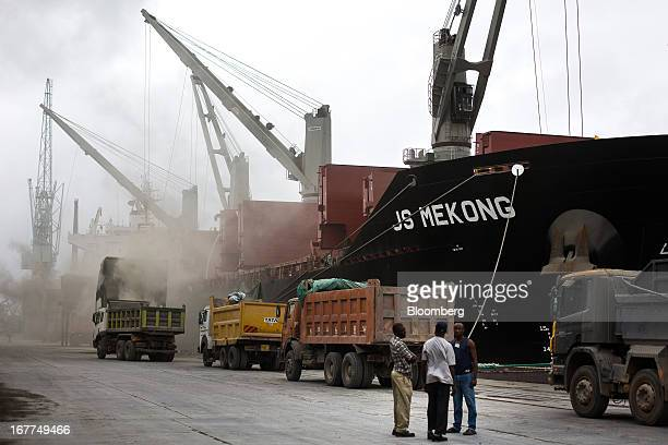 Cranes are seen unloading 'Clinker' from the JS Mekong a bulk carrier ship and into waiting trucks while on the dockside at Mombasa port managed by...