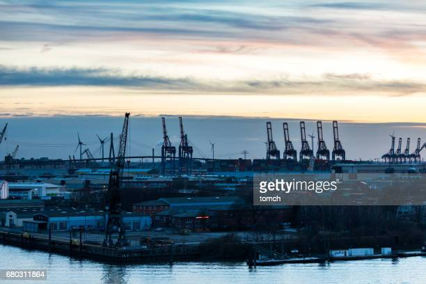 Cranes at the port of Hamburg at sunset, Germany