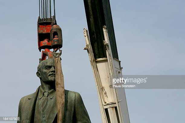 A crane's hoist is attached to the statue of the Vladimir Lenin during a ceremony to remove it after many decades on October 14 2012 in Ulan Bator...