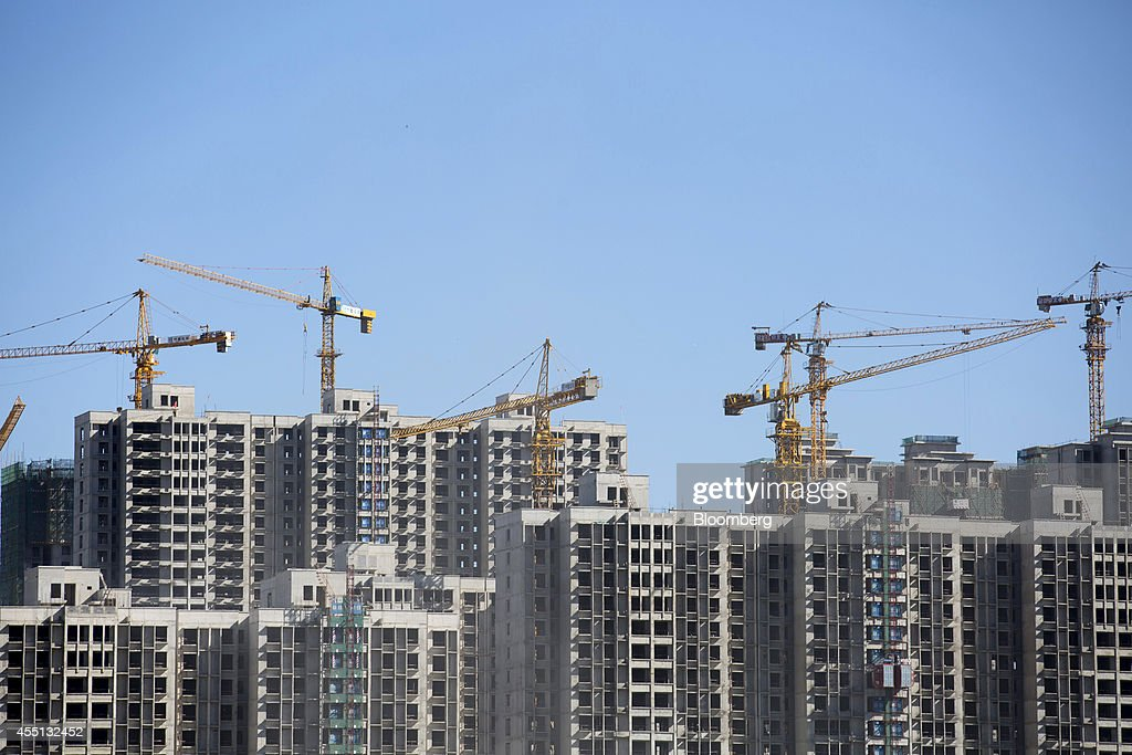 Cranes operate at a residential construction site in Beijing, China, on Monday, Sept. 8, 2014. China is scheduled to release figures on consumer and producer prices on Sept. 11. Photographer: Brent Lewin/Bloomberg via Getty Images