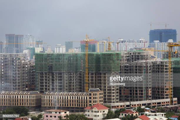 Cranes operate at the One Park construction site developed by Graticity Real Estate Development Co in Phnom Penh Cambodia on Tuesday Oct 24 2017...