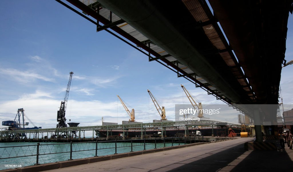 Cranes operate at the Port of Cigading near the PT Krakatau Steel plant in Cilegon, Banten province, Indonesia, on Thursday, Feb. 21, 2013. Krakatau Steel is Indonesia's biggest maker of the metal. Photographer: Dadang Tri/Bloomberg via Getty Images