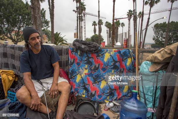 Cranes rise over a construction site near a homeless man's sidewalk encampment on May 1 2017 in Los Angeles California The newly released 2017...