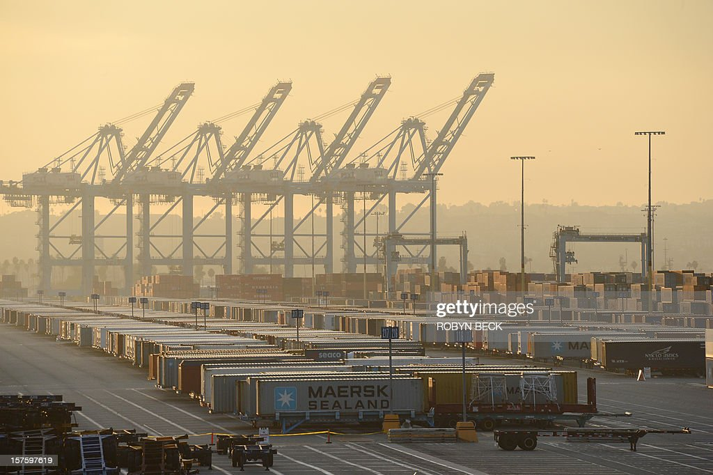 Cranes sit idle surrounded by shipping containers December 4, 2012 at the Port of Los Angeles in southern California as a strike by port clerical workers enters its second week. A federal mediator has been called in to try to break a strike deadlock which has crippled a key US trade hub for the last week. The strike by clerical workers at the ports of Los Angeles and Long Beach, which handle more than 40 percent of ocean-shipped US imports from Asia, is costing billions to the local and wider US economy. The White House said it was monitoring the standoff closely, and LA Mayor Antonio Villaraigosa announced the two sides had agreed to federal mediation, after he spent the night in negotiations himself. AFP PHOTO / Robyn BECK