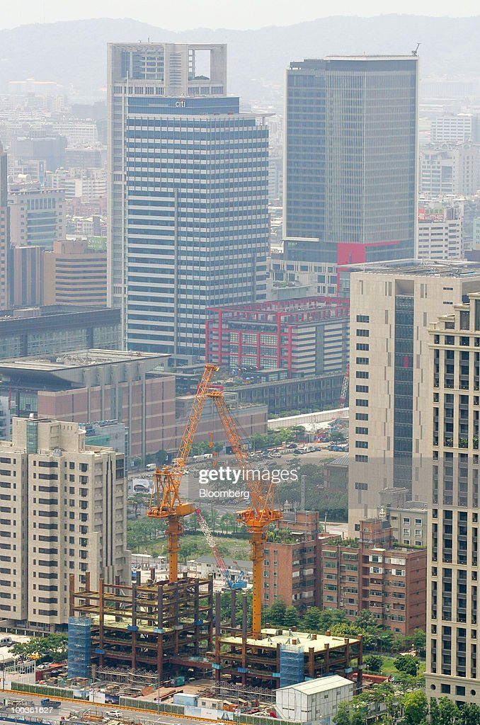 Cranes stand at a construction site in Taipei, Taiwan, on Saturday, May 22, 2010. Investors should sell Taipei property now, taking advantage of a 21-month rally in prices before the government acts to make real estate more affordable, according to the Taiwan Real Estate Research Center and the island's largest real-estate brokerage. Photographer: Maurice Tsai/Bloomberg via Getty Images