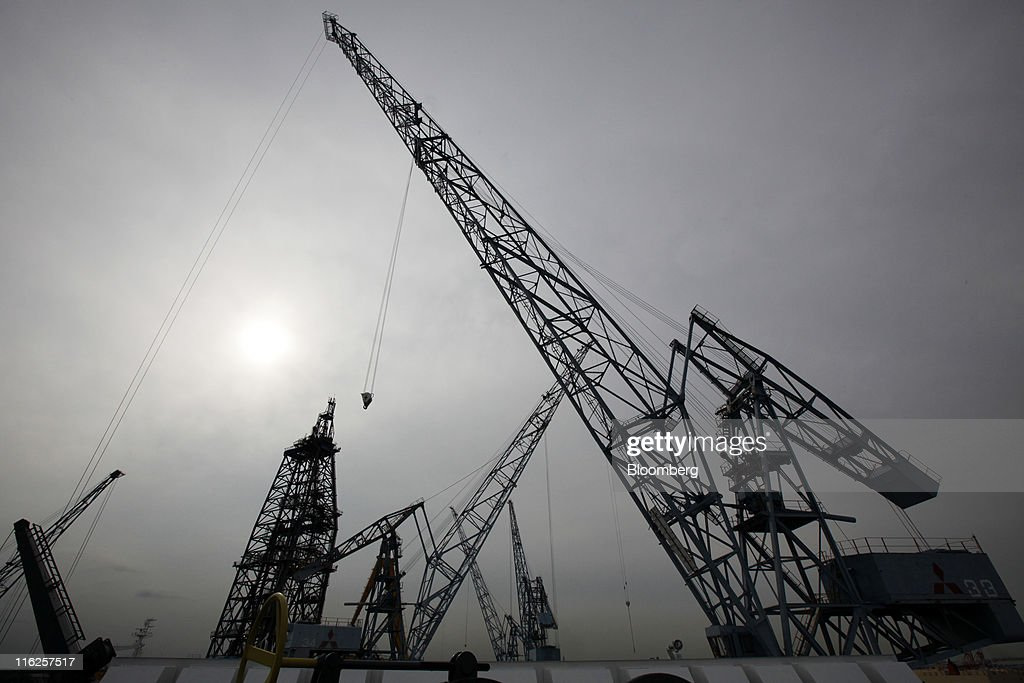 Cranes stand at Mitsubishi Heavy Industries Ltd.'s Honmoku plant in Yokohama city, Kanagawa prefecture, Japan, on Wednesday, June 15, 2011. Nippon Yusen K.K. is Japan's largest shipping line. Photographer: Tomohiro Ohsumi/Bloomberg via Getty Images