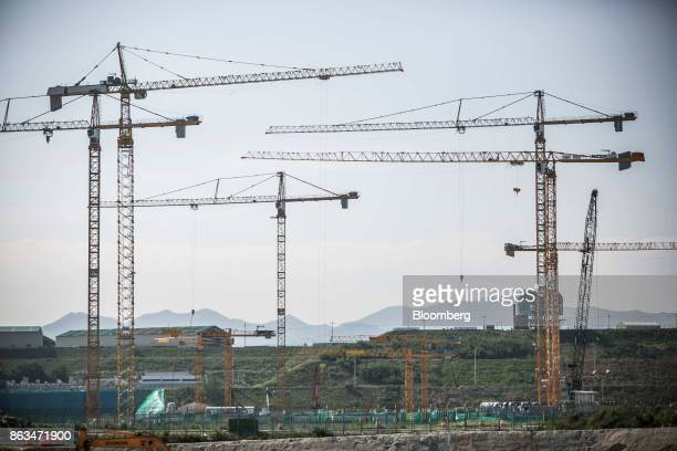 Cranes stand at the temporarily suspended construction site of the ShinKori No 5 and 6 nuclear power reactors owned by Korea Hydro Nuclear Power Co...