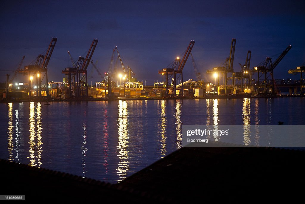 Cranes stand idle in the port area of Rio de Janeiro, Brazil, on Sunday, Nov. 24, 2013. The government will auction three highways before year-end, Finance Minister Guido Mantega told reporters Nov. 22 in Brasilia. Photographer: Dado Galdieri/Bloomberg via Getty Images