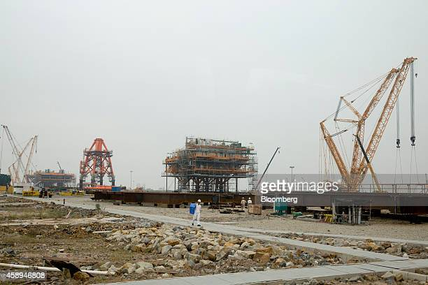 Cranes stand on a drilling platform construction site at the yard of Offshore Oil Engineering Co a unit of CNOOC Ltd in the Zhuhai Gaolan Port...