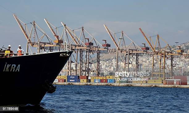 Cranes stand unmanned on a dockside during a strike at the container terminal in Piraeus on October 12 2009 The empty due to the strike container...