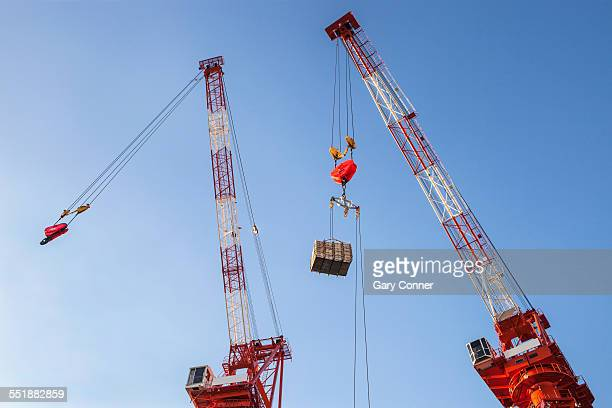 Cranes with pulleys hooks and load