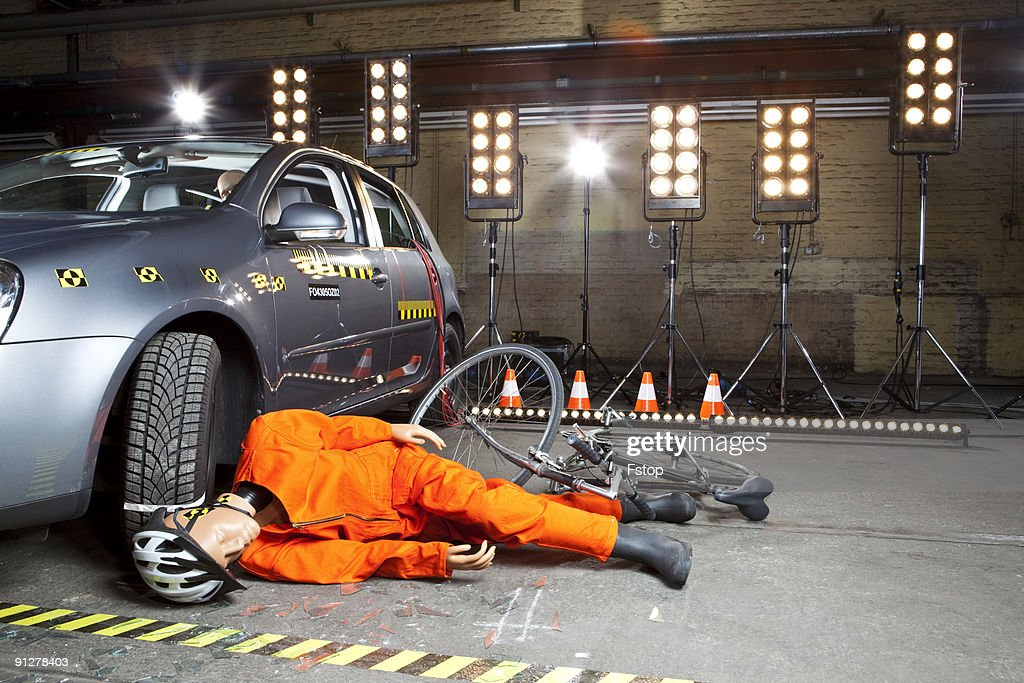 a crash test dummy on ground after bicycle crashed stock photo getty images. Black Bedroom Furniture Sets. Home Design Ideas