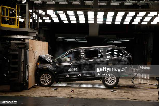 A crash test dummy's head hits the airbag in a Ford Motor Co 2014 Explorer XLT during a head on 30 mile per hour crash test at the company's Crash...