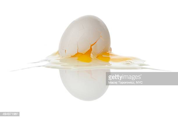 Crashed egg on white background