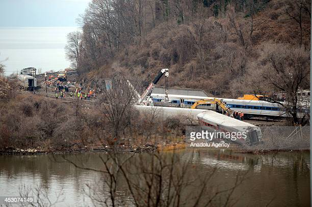 Crashed train wagons removal near the Spuyteh Duyvil station started on December 2 2013 in New York City The MetroNorth passenger train derailed en...