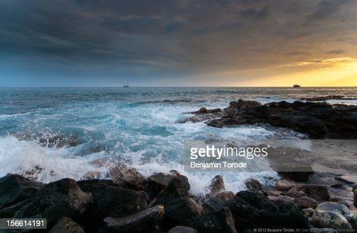 Crashing waves at sunset on Kona coast, Hawaii