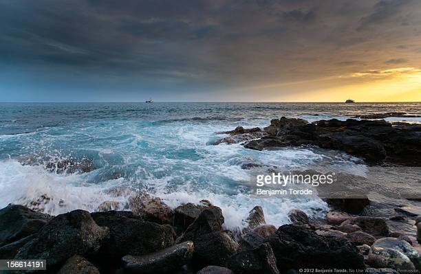 Crashing waves at sunset on Kona coast, Hawaii