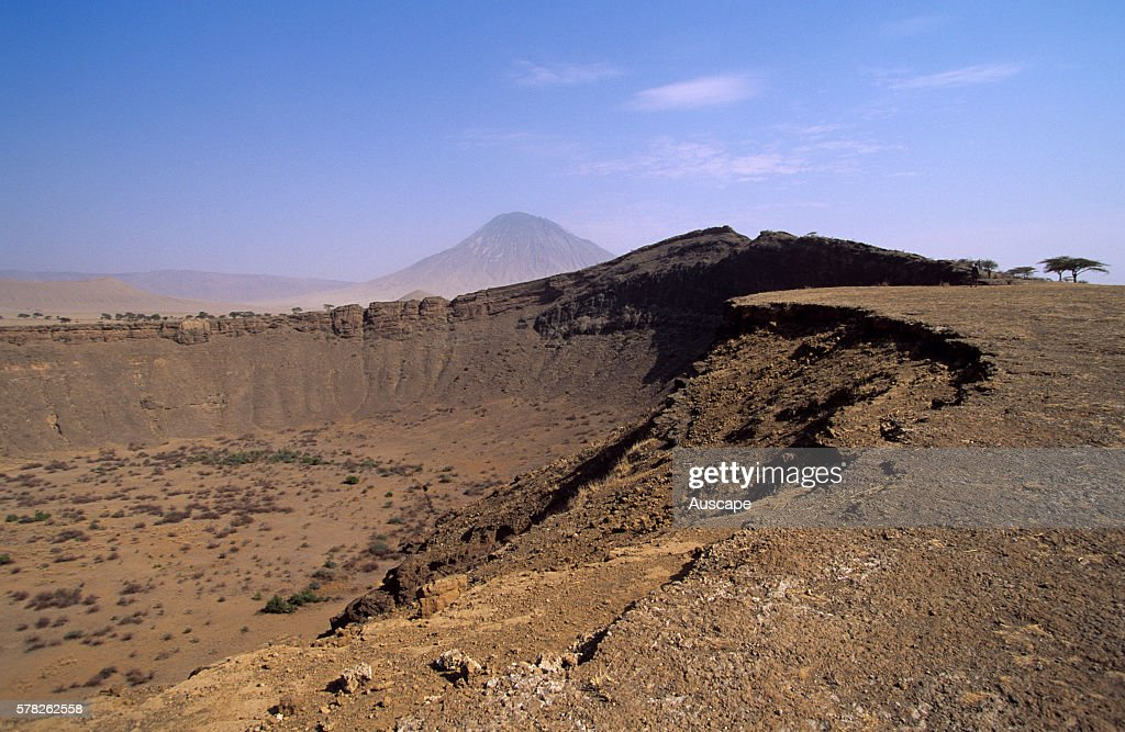 Crater and Ol Doinyo Lengai beyond Ol Doinyo Lengai is an active volcano that last erupted in 20072008 Edge of the Great Rift Valley Tanzania