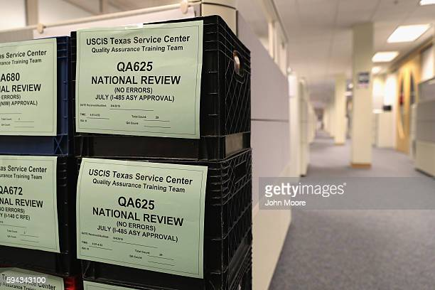Crates containing immigrants' permanent residency applications await processing at the US Citizenship and Immigration Services Texas Service Center...