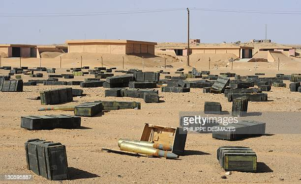 Crates containing tank shells litter the desert close to ammunition storage bunkers located in the desert some 100kms south of Sirte on October 26...