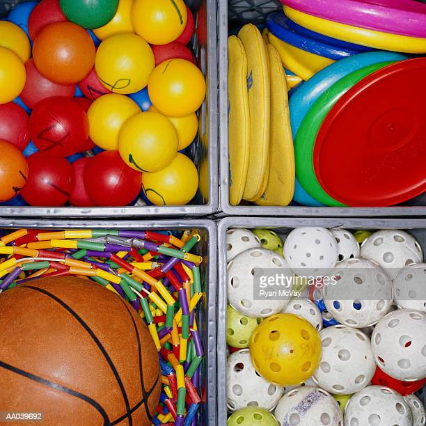 Crates full of children's sports equipment, close-up, overhead view