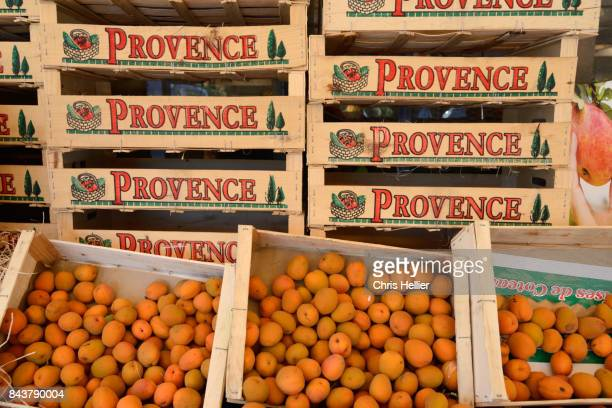 Crates of Apricots on Market Stall Provence