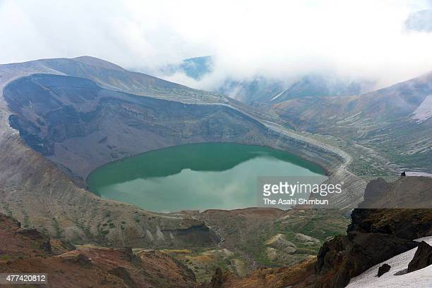A crator lake called 'Okama' is seen after the Japan Meteorological Agency has lifted a ban to approach to the crator as the volcanic activity around...