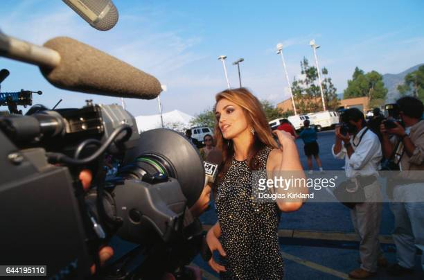 Crawford being interviewed by the Paparazzi as she arrives at the ceremony