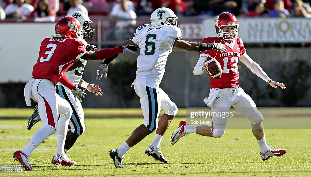Crawford Jones #13 of the Houston Cougars looks for a open receiver as Lorenzo Doss #6 of the Tulane Green Wave pursues at Robertson Stadium on November 24, 2012 in Houston, Texas. Houston defeats Tulane 40-17.
