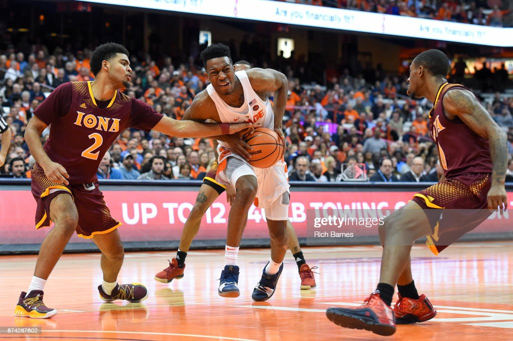 E.J. Crawford #2 of the Iona Gaels reaches to steal the ball from Tyus Battle #25 of the Syracuse Orange during the second half at the Carrier Dome on November 14, 2017 in Syracuse, New York. Syracuse defeated Iona 71-62.