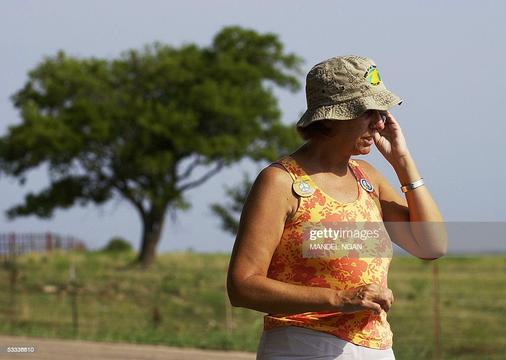 Cindy Sheehan of Gold Star Families for Peace speaks on a mobile phone on the side of a road leading to the ranch of US President George W. Bush, 07 August 2005 in Crawford, TX. Sheehan's son Casey Sheehan was one of the 1,810 US soldiers killed in Iraq since the March 2003 invasion. Sheehan plans to camp outat the site until she gets a chance to speak to Bush about the death of her son. Sheehan has not seen Bush, but she did talk for about 45 minutes 06 August with Steve Hadley, Bush's national security adviser, and Joe Hagin, deputy White House chief of staff, who went out to hear her concerns. AFP PHOTO/Mandel NGAN