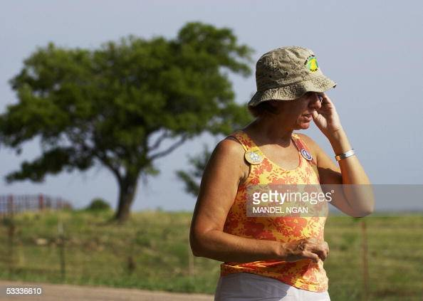 Cindy Sheehan of Gold Star Families for Peace speaks on a mobile phone on the side of a road leading to the ranch of US President George W Bush 07...