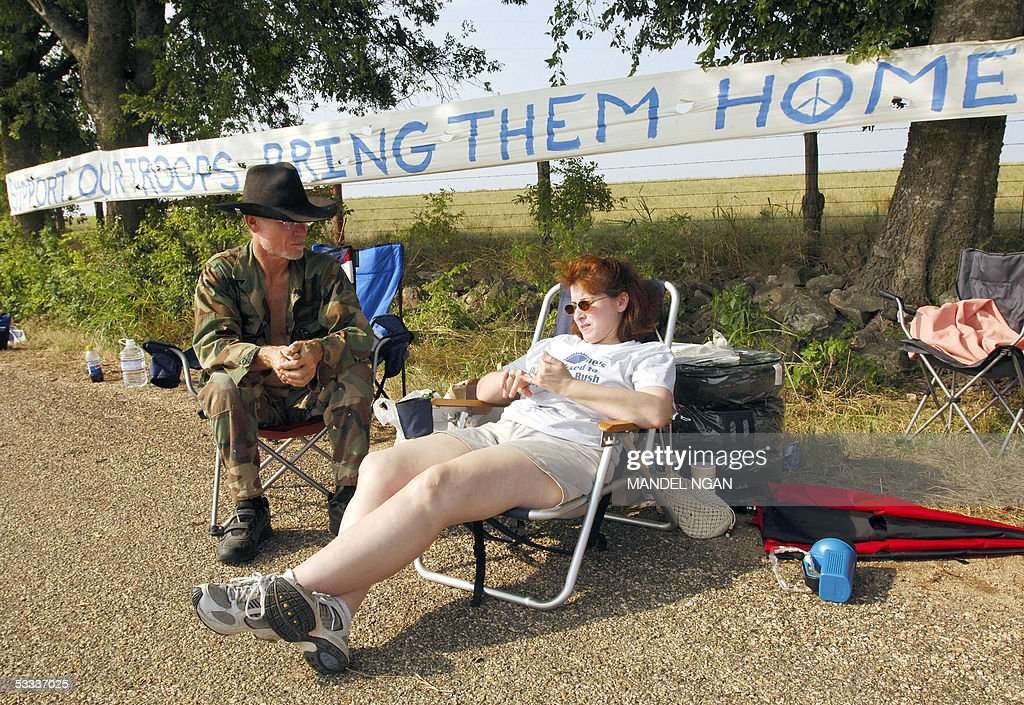 Supporters of Cindy Sheehan, of Gold Star Families for Peace, chat at her makeshift camp on the side of a road leading to the ranch of US President George W. Bush, 07 August 2005 in Crawford, TX. Sheehan's son Casey Sheehan was one of the 1,810 US soldiers killed in Iraq since the March 2003 invasion. Sheehan plans to camp out until she gets a chance to speak to Bush about the death of her son. AFP PHOTO/Mandel NGAN