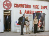 US President George W Bush and First Lady Laura Bush step out of the Crawford Fire station 07 November 2006 after casting their vote in the...