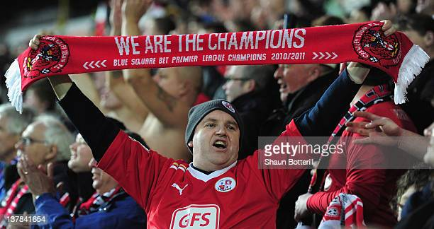 Crawley Town fans celebrate at the end of the FA Cup with Budweiser Fourth Round match between Hull City and Crawley Town at KC Stadium on January 28...