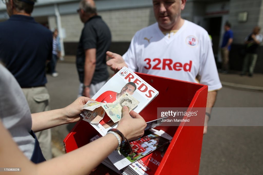 A Crawley Town supporter purchases a programme ahead of the Sky Bet League One match between Crawley Town FC and Coventry at Broadfield Stadium on August 03, 2013 in Crawley, West Sussex.