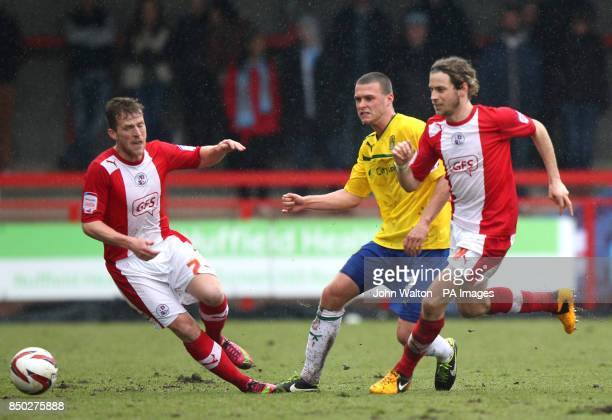 Crawley Town's Billy Clarke and Sergio Torres battle for the ball with Coventry City's Billy Daniels