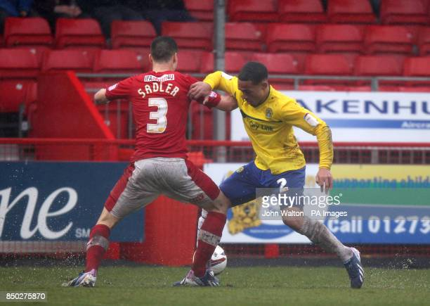 Crawley Town's Mathew Sadler and Coventry City's Jordon Clarke battle for the ball