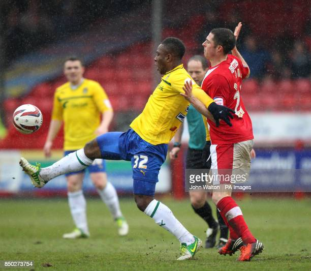 Crawley Town's Mike Jones and Coventry City's Franck Moussa battle for the ball