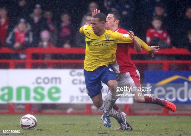 Crawley Town's Mike Jones pulls back Coventry City's Jordan Clarke during the npower Football League One match Broadfield Stadium Crawley
