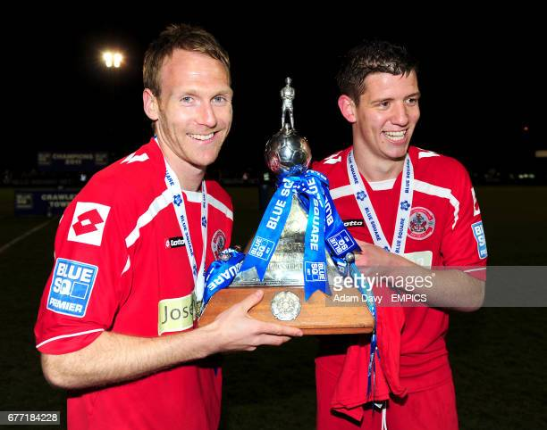 Crawley Town's Simon Rusk and Glenn Wilson celebrate with the Blue Square Bet Football Conference Championship Trophy