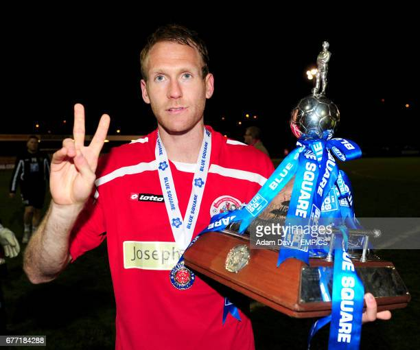 Crawley Town's Simon Rusk celebrates with the Blue Square Bet Football Conference Championship Trophy